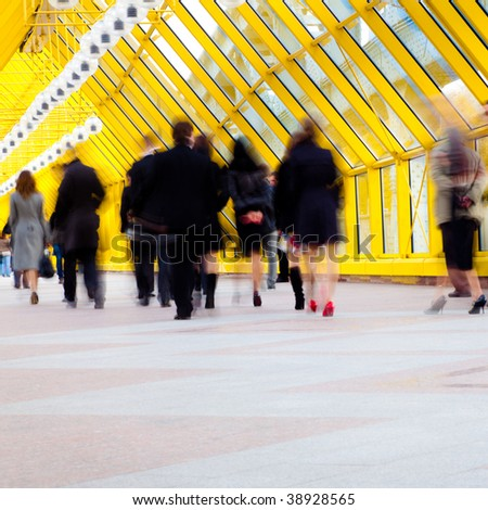 Crowd move in modern yellow corridor - stock photo