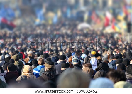 Crowd of anonymous people on street in city center, selective focus - stock photo