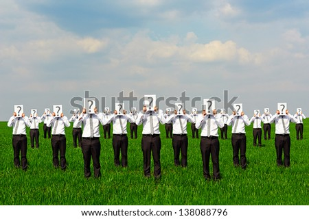 crowd of businessmen with question mark. concept photo - stock photo