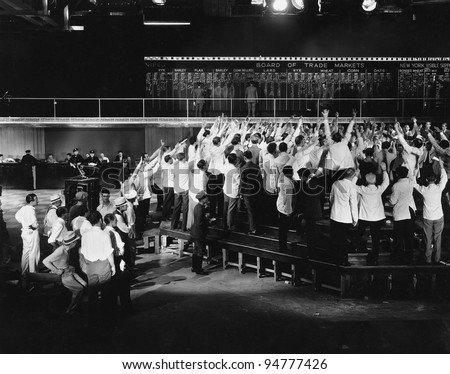 Crowd of excited traders at stock exchange - stock photo