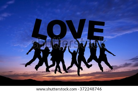 Crowd of friends jumping with LOVE on blue sky background - stock photo
