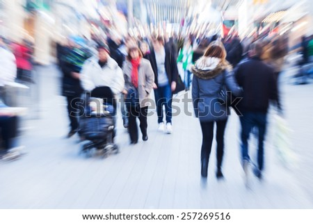 crowd of people in the city with creative zoom effect - stock photo