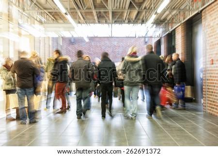 Crowd of people rushing through corridor, zoom effect, motion blur - stock photo