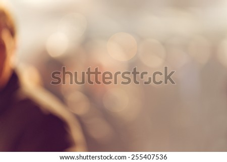 Crowd of People Walking On the Street in Bokeh, unrecognizable group of men and women as blur urban background. - stock photo