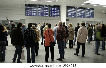 crowd waiting at arrival gate for passengers to exit - stock photo