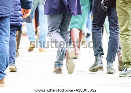 Crowd walking on street - stock photo