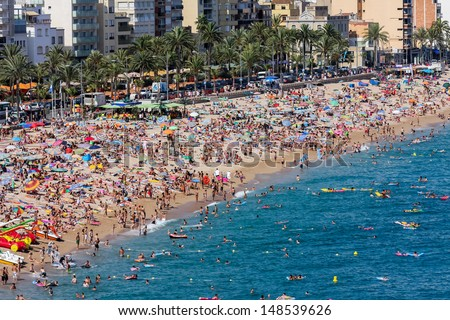 Crowded beach at Lloret de Mar in Spain - stock photo