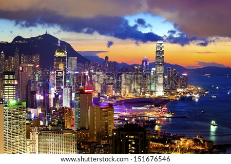 Crowded downtown and building in Hong Kong at sunset - stock photo