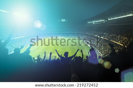 crowded football stadium  - stock photo