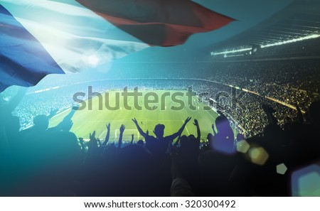 crowded football stadium with french flag - stock photo