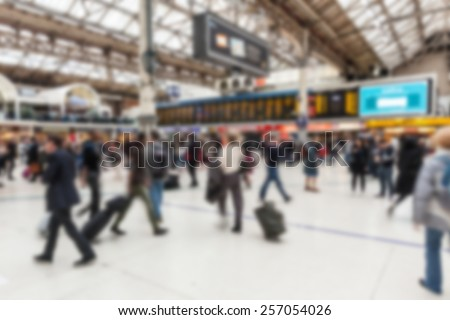 Crowded station during rush hour in London, blurred background - stock photo