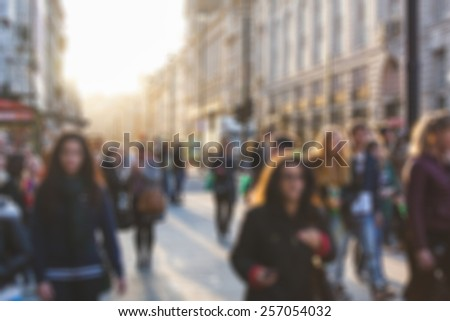 Crowded street in London, blurred background - stock photo