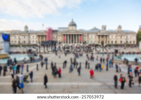 Crowded Trafalgar Square with National Gallery, blurred background - stock photo