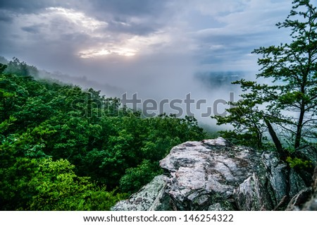 crowders mountain views with clouds and fog at sunset - stock photo