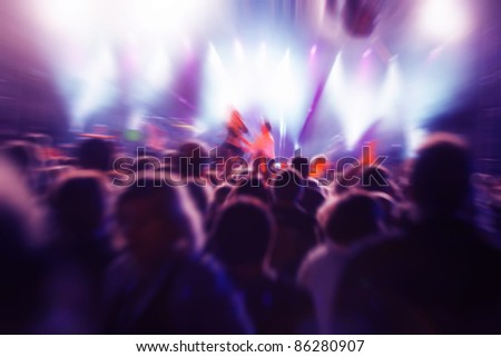 Crowds of people having fun on a music concert - stock photo
