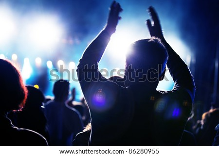 Crowds of people having fun on a music concert