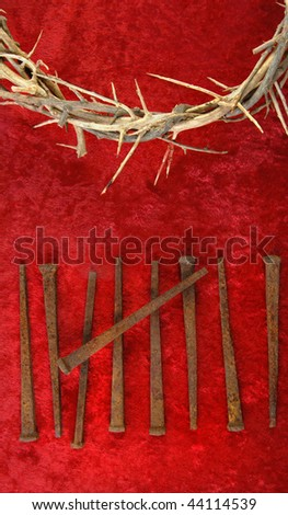 Crown of Thorns with metal spikes on red background. - stock photo