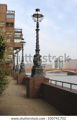 Crown Reach Riverside Walk, Westminster, London, England. With Vauxhall Bridge over River Thames in background. - stock photo