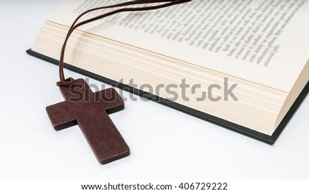 Crucifix and bible in background. - stock photo
