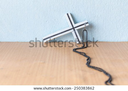 Crucifix lying on the floor - stock photo