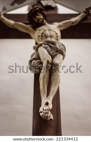 Crucifix. Selective focus on feet - stock photo