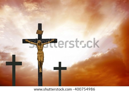 Crucifixion.Easter religious concept with christian cross on dramatic cloudscape - stock photo