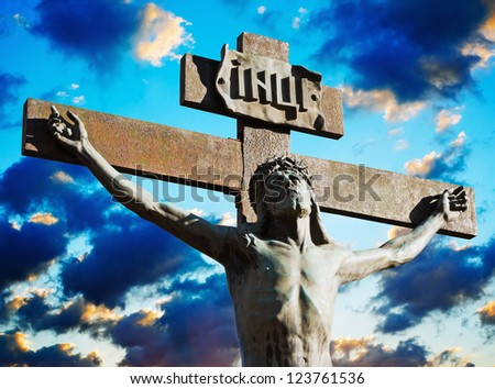Crucifixion of Jesus Christ on a background cloudy sky - stock photo