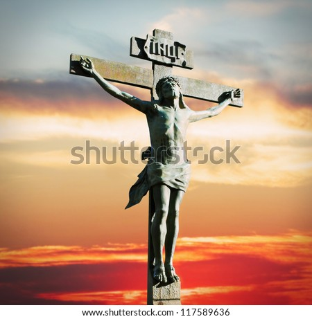 Crucifixion of Jesus Christ on the sunset in the sky - stock photo