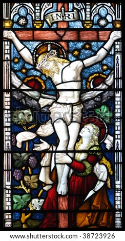 Crucifixion of Jesus in stained glass - stock photo