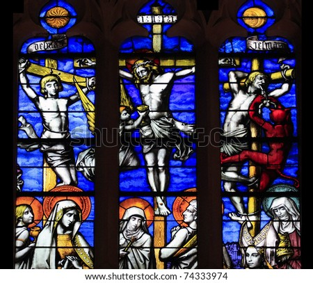 Crucifixion of Jesus, stained glass in the old Hospital of Beaune, France - stock photo