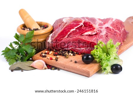 Crude meat and spice on white background - stock photo