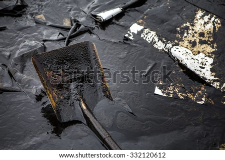 Crude oil on oil spill is accident  on a beach at  Ao Prao Beach, Koh Samet, Rayong, Thailand - stock photo