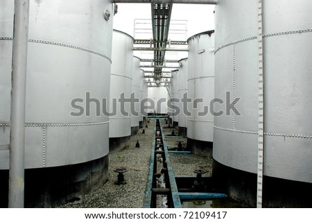 crude oil storage tanks in areas of petroleum  drilling - stock photo
