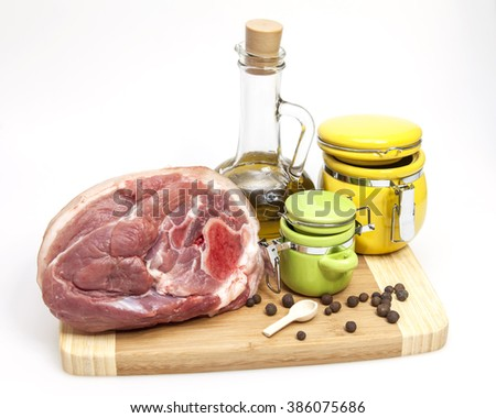 Crude pork hough, spices and kitchen utensils  - stock photo