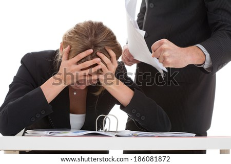 Cruel boss bullying hard working for him woman - stock photo