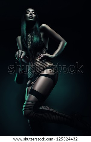 cruel woman with whip - stock photo