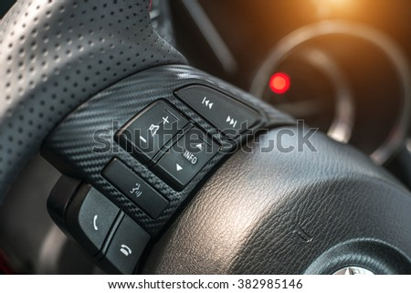 Cruise control buttons on the steering wheel. - stock photo