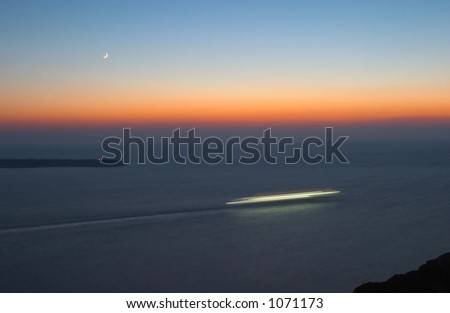 Cruise liner at the sunset and moonrise - stock photo