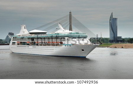 Cruise liner leave Riga port. - stock photo