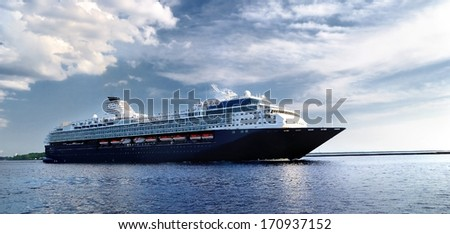 cruise liner leaving the port of Riga - stock photo