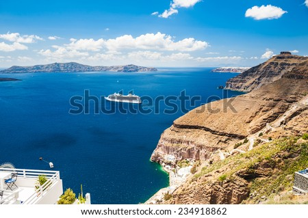Cruise liner near the Greek Islands. Beautiful landscape with sea view. Santorini island, Greece - stock photo