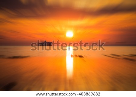 Cruise liner ship in sunset in sea - stock photo