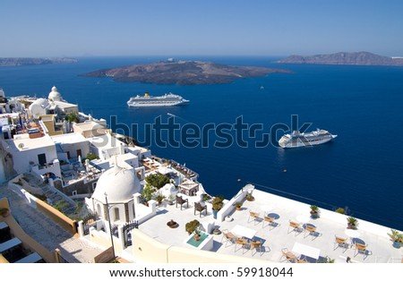 cruise liners moored in the caldera of santorini island, greece