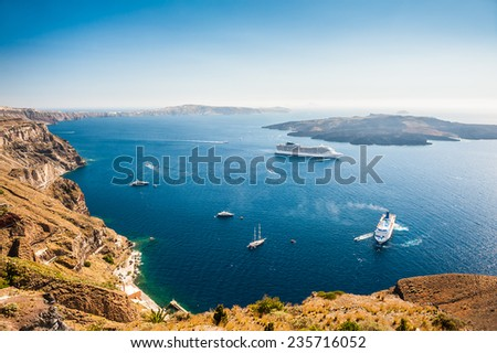 Cruise liners near the Greek Islands. Beautiful landscape with sea view. Santorini island, Greece - stock photo