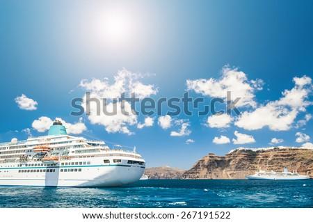 Cruise liners near the Santorini island, Greece. Beautiful landscape with sea view. - stock photo