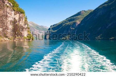 Cruise on Geiranger fjord, Norway - stock photo