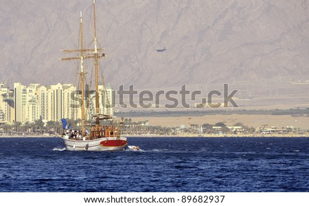 Cruise on pleasure yacht in the Aqaba gulf near Eilat - famous resort and recreation city of Israel - stock photo