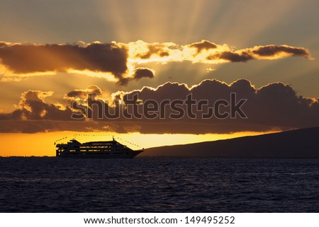 Cruise Ship against beautiful Hawaiian sunset - stock photo