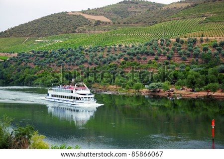 Cruise ship at Foz do Tua, Douro Valley, Portugal, with the Port wine vineyards in the background - stock photo