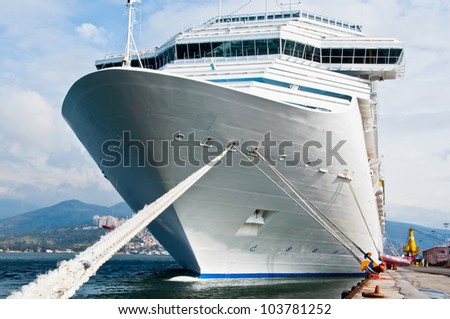 Cruise ship bow on a beautiful day. - stock photo